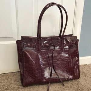 Jessica Simpson faux leather brief bag.